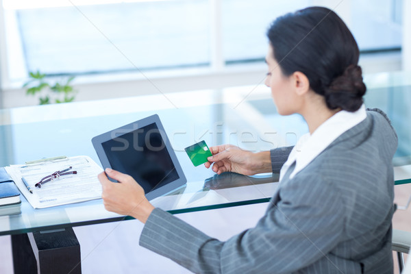 Businesswoman doing online shopping in office Stock photo © wavebreak_media