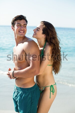 Boldog pár fürdőruha néz kamera tengerpart Stock fotó © wavebreak_media