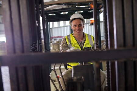 Driver operating forklift machine in warehouse Stock photo © wavebreak_media