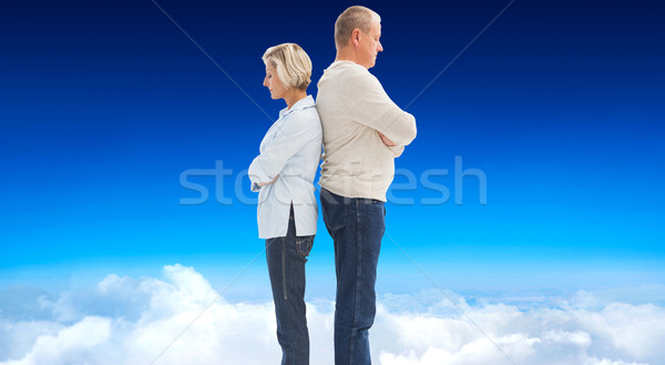 Stock photo: Composite image of unhappy couple not speaking to each other