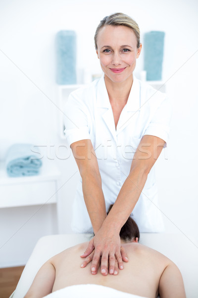 Physiotherapist doing back massage  Stock photo © wavebreak_media
