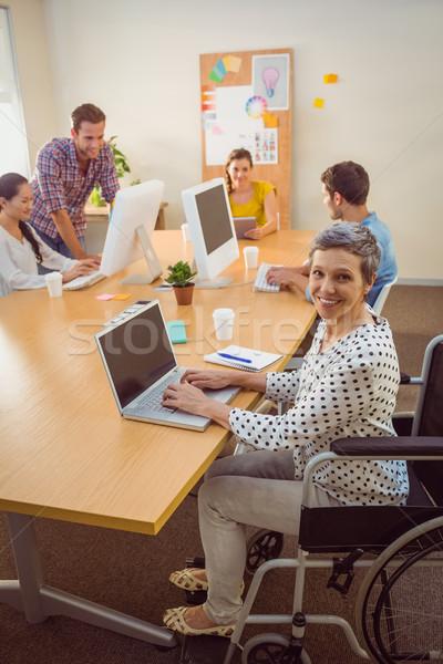 Creative casual businesswoman in wheelchair Stock photo © wavebreak_media