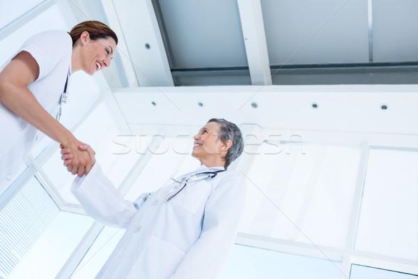 Smiling medical colleagues shaking hands Stock photo © wavebreak_media