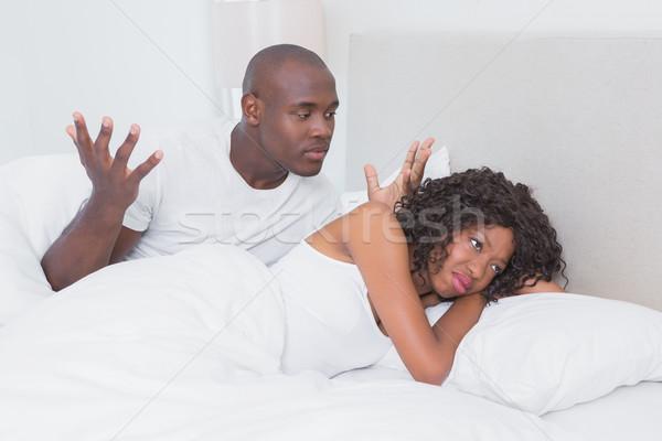 Vitatkozás pár ágy együtt otthon hálószoba Stock fotó © wavebreak_media