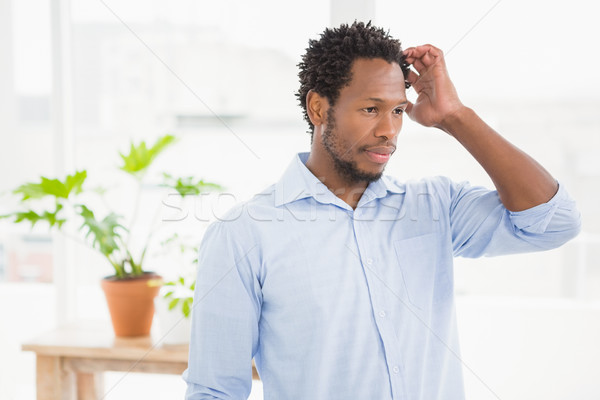 Young thinking businessman scratching his head Stock photo © wavebreak_media
