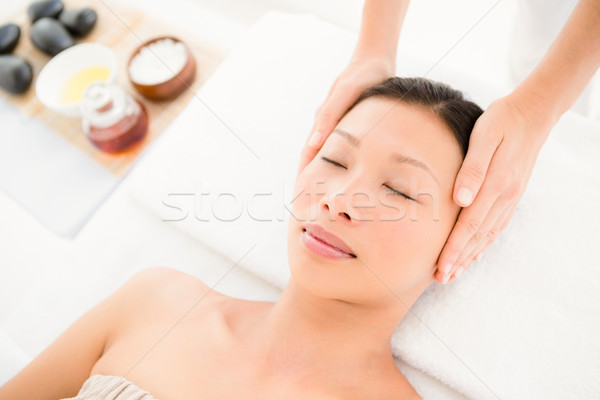 Stock photo: Attractive young woman receiving head massage at spa center