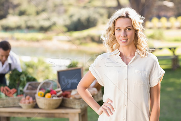 Smiling blonde woman with hands on hips Stock photo © wavebreak_media