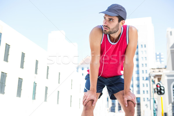 Exhausted athlete leaning forward after an effort Stock photo © wavebreak_media