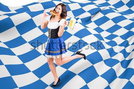 Female runner on track against blue background and checkered flag Stock photo © wavebreak_media
