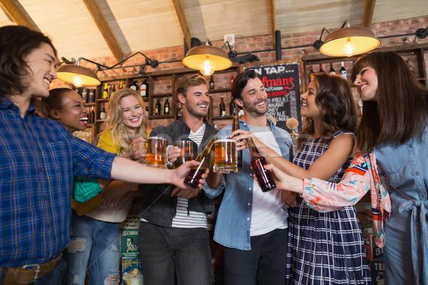 Gelukkig vrienden bier bril flessen Stockfoto © wavebreak_media