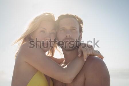 Thoughtful couple embracing at beach Stock photo © wavebreak_media