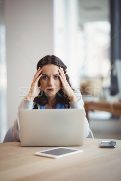 Portrait tired executive sitting with laptop at desk Stock photo © wavebreak_media