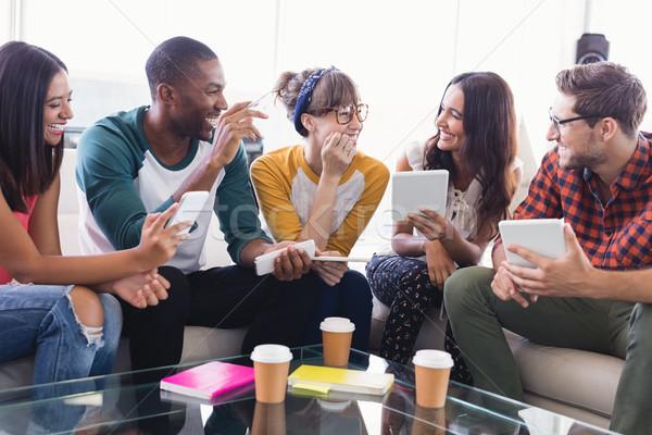 Gelukkig zakenlieden tablet computers vergadering sofa Stockfoto © wavebreak_media