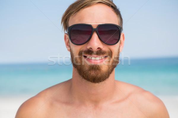 Close up portrait of shirtless man wearing sunglasses Stock photo © wavebreak_media