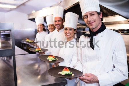 Chefs alimentaire plaques portrait commerciaux Photo stock © wavebreak_media