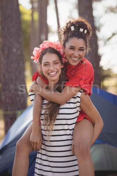 Portrait of cheerful woman piggybacking her female friend Stock photo © wavebreak_media
