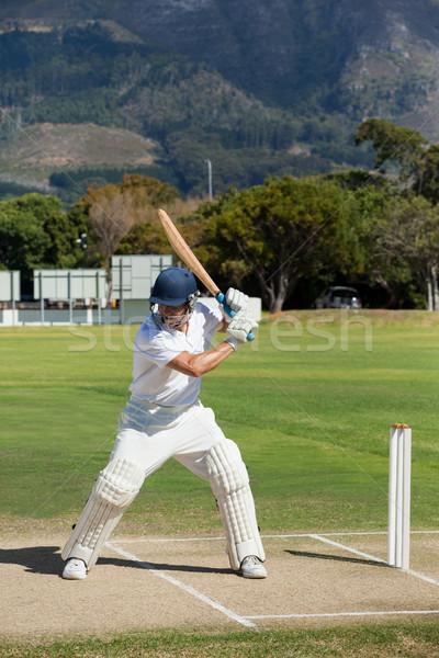 Cricket player practicing on field Stock photo © wavebreak_media