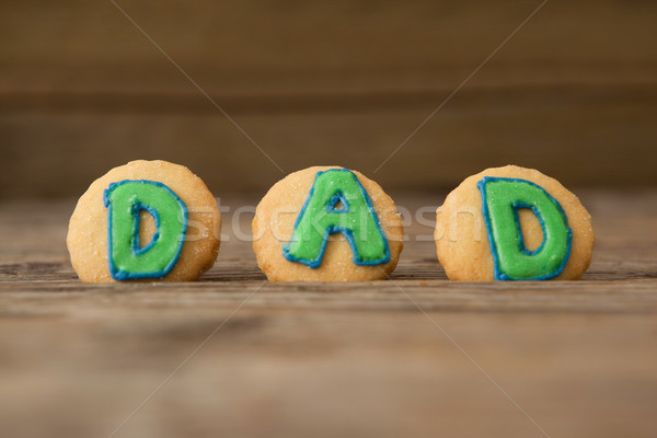 Cookies with text dad on arranged wooden plank Stock photo © wavebreak_media