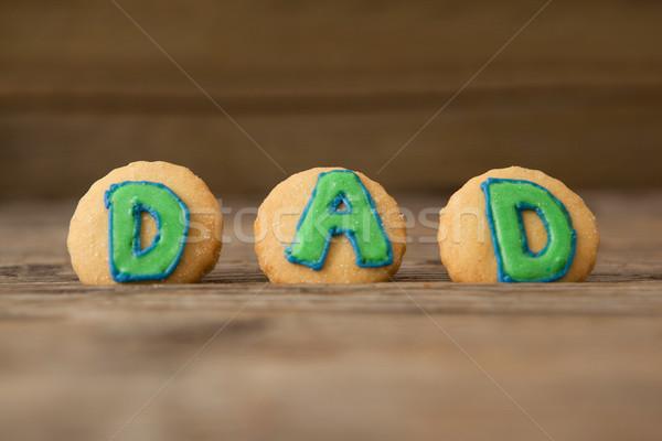 Sütik szöveg apa fából készült palánk közelkép Stock fotó © wavebreak_media
