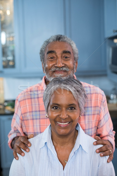 Portrait of smiling couple at home Stock photo © wavebreak_media
