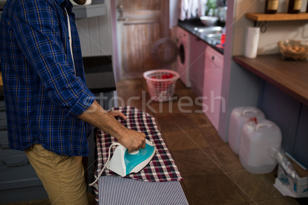 Midsection of man ironing shirt Stock photo © wavebreak_media