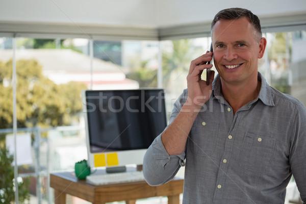 портрет улыбаясь дизайнера говорить служба Сток-фото © wavebreak_media