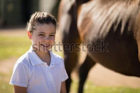 Portré mosolyog lány áll ranch napos idő Stock fotó © wavebreak_media