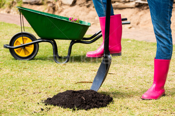 Low section of woman in pink boots with shovel Stock photo © wavebreak_media