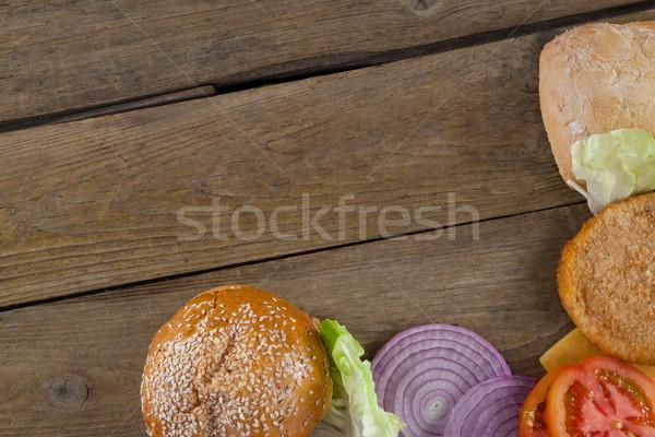 Warzyw składnik hamburger drewniany stół Zdjęcia stock © wavebreak_media