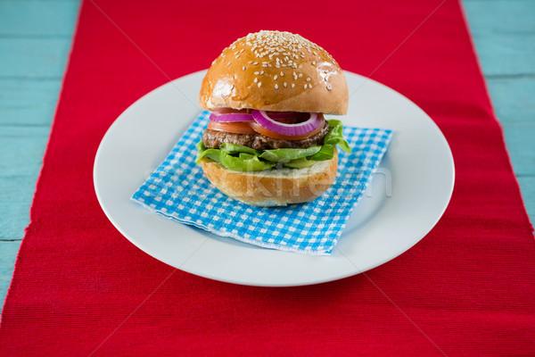 Hamburger servi serviette plaque table Photo stock © wavebreak_media