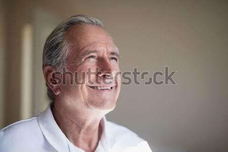 Close-up of smiling senior male patient looking away Stock photo © wavebreak_media