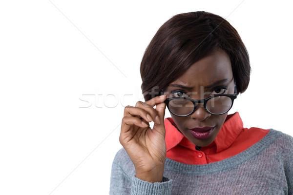 Portrait jeune femme lunettes blanche mode Photo stock © wavebreak_media