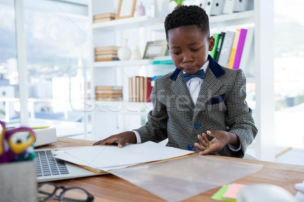 Businessman checking file while sitting at desk Stock photo © wavebreak_media