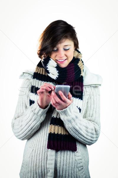 Cute woman using her smartphone Stock photo © wavebreak_media