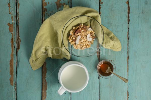 Tigela cereais matinais mel leite mesa de madeira fitness Foto stock © wavebreak_media