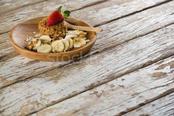 Granola bár gyümölcsök felszolgált tányér közelkép Stock fotó © wavebreak_media