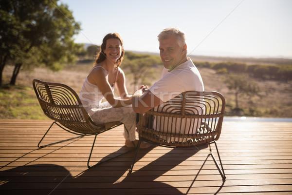 Senior couple sitting on chairs at the resort Stock photo © wavebreak_media