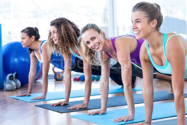 Attractive women doing plank pose in fitness center Stock photo © wavebreak_media