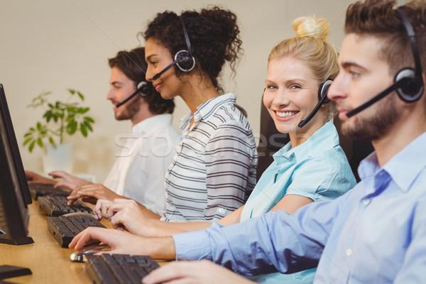 портрет улыбаясь деловая женщина Call Center рабочих компьютер Сток-фото © wavebreak_media