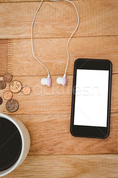 Kawy czarny smartphone biały słuchawki drewna Zdjęcia stock © wavebreak_media