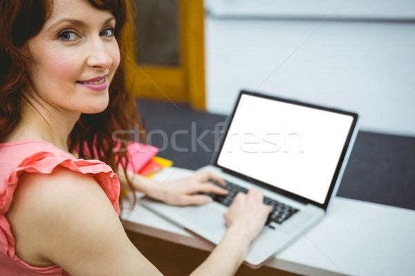 Mature student in lecture hall using laptop Stock photo © wavebreak_media