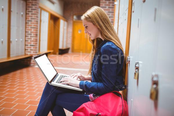 Smiling student sitting at the computer Stock photo © wavebreak_media