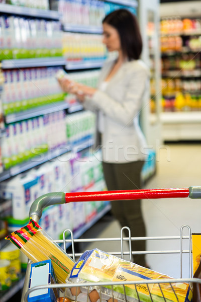 Woman looking at product in aisle  Stock photo © wavebreak_media