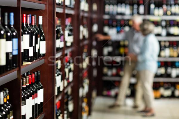 Smiling senior couple choosing wine Stock photo © wavebreak_media