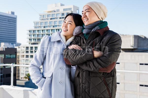 Souriant couple bâtiment homme heureux Photo stock © wavebreak_media