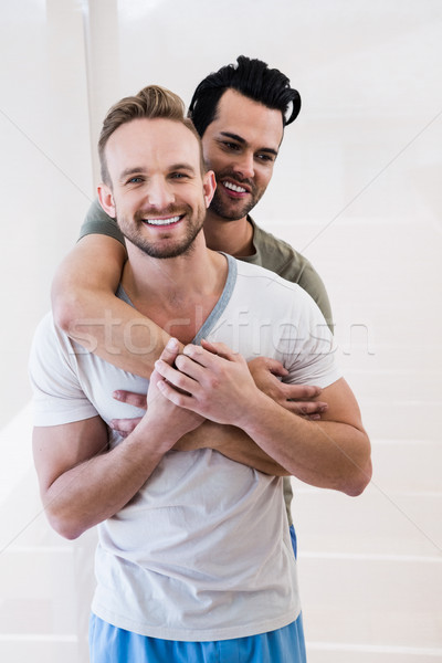笑みを浮かべて ゲイ カップル ホーム 家 ストックフォト © wavebreak_media