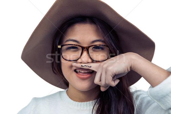 азиатских женщину усы пальца позируют камеры Сток-фото © wavebreak_media