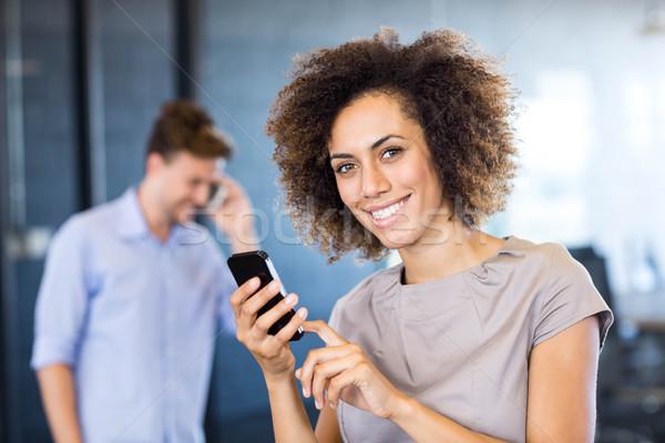 Colleagues communicating on mobile phone Stock photo © wavebreak_media