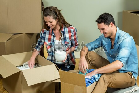 Couple using digital tablet while relaxing in new house Stock photo © wavebreak_media