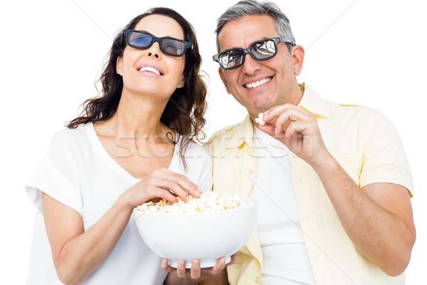Souriant couple lunettes 3d manger popcorn blanche Photo stock © wavebreak_media